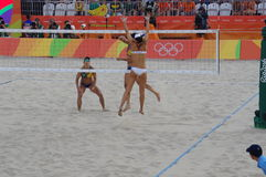 Power block by Lauren Fendrick. From USA during Women's beach volleyball competition in the game against Brazil's Larissa Franca and Talita Antunes. Picture Stock Image