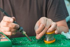 Power board repair with soldering iron and solder stock photo