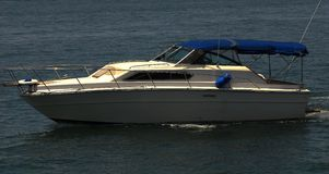 Power Boat 2. Power boat speeding across bay royalty free stock photo