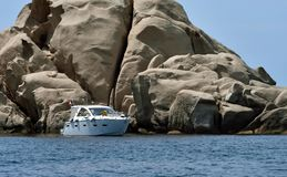 Power boat at anchor. Power boat at anchor in the Scoglio Bianco, small cove in the west coast of Corsica. France royalty free stock images