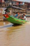 Power boat travels waterway. KOMPONG KLEANG, CAMBODIA - FEB 12, 2015 - Power boat travels along the waterway of Kompong Kleang floating fishing village, Cambodia stock images