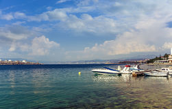 Power boats parked on the sea. The background is a beautiful blue sky and clouds royalty free stock photos