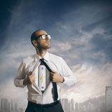 Power in business. Concept of power in business with battery pack under the shirt Stock Image