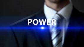 Power, businessman in suit standing in front of screen, influence and strength. Stock photo royalty free stock images