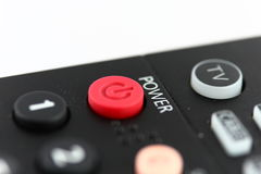 Red Power Button on TV Remote Control Stock Image