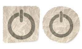 Power button. Crumpled slip of paper and a power button Stock Images