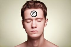 Power button in the forehead Royalty Free Stock Photography