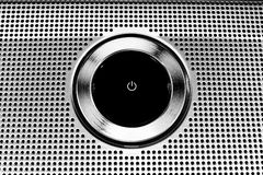 Power Button - Metallic. Black Plastic Power Button close-up Royalty Free Stock Photography