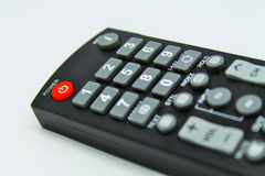 Power button. The red power button of black remote controller Royalty Free Stock Photos