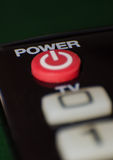 Power button on the TV remote control. Close-up red power button on the TV remote control royalty free stock photography