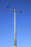 Power and cable. On blue sky Stock Photography
