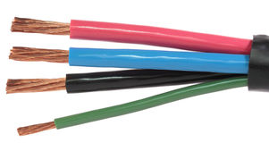 Power cable. The cleared electric power cable with four lines Stock Photos