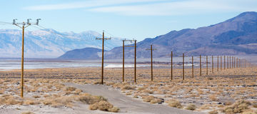 Power cable in desert Royalty Free Stock Photos