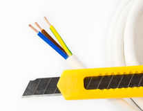 Power cable and knife Stock Photography