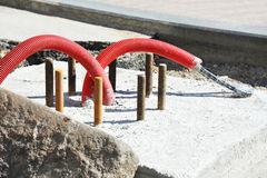 Power cable in PVC pipe. Installation of power cable in flexible PVC pipe Royalty Free Stock Photo
