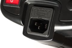 Power cable socket of a black studio illuminator stock photos