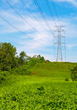 Power cable tower on a hill top. Concept of power transmission royalty free stock photo