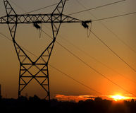 Power cables. Power pylon over sunset view stock image