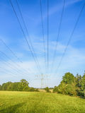 Power calbe over green meadow Royalty Free Stock Photography