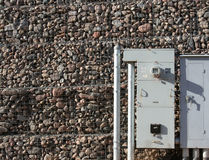 Power center. Electrical Box with meter for commercial use with copyspace - rock wall behind royalty free stock photo