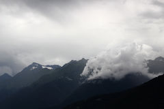 The power of cloud. High in the mountains, in the embrace of clouds, fog, mountains, cold Stock Photos