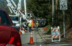Power company workers working on power lines royalty free stock photos