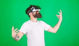Power concept. Hipster on shouting face raising hands powerfully while interact in virtual reality. Guy with head. Mounted display interact in VR. Man with royalty free stock photography