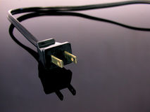 Power Cord long cord. Photo of Power Cord shot on Black Galss Royalty Free Stock Images