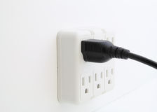 Power cord plugged into wall outlet. Stock Images