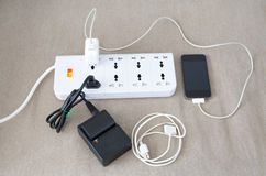 Power cord with several adapters and chargers for various electr Royalty Free Stock Photo