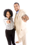 Power couple pointing Royalty Free Stock Photos