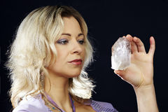 Power of crystal. Woman of esoteric soul holding some symbols of taoism and alternative life styles stock photography