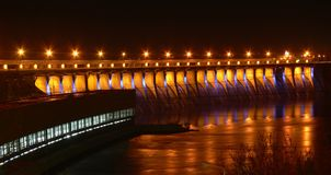 Power dam in the night. Hydroelectric dam in the night with road lights reflecting from the river Stock Photo