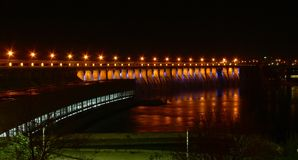 Power dam in the night. Hydroelectric dam in the night with road lights reflecting from the river Royalty Free Stock Images