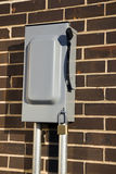 Power Disconnect. Outdoor Power Disconnect mounted on brick wall stock photos