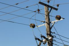 Power distribution. Electricity wires on a telegraph pole utility post. Power distribution. Electrical wires and junction cabling on top of a high voltage stock photos