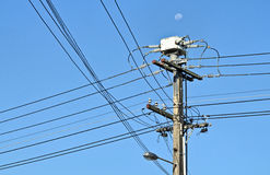 Power distribution. Power pole in sunny summer day, Auckland, New Zealand Stock Image