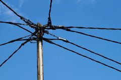 Power distribution. A power pole with wires in different directions Stock Photos