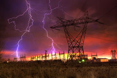 Power Distribution Station with Lightning Strike. royalty free stock image