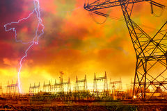 Power Distribution Station with Lightning Strike. Dramatic Image of Power Distribution Station with Lightning Striking Electricity Towers royalty free stock image