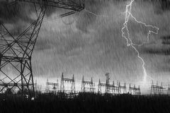 Power Distribution Station with Lightning Strike. Royalty Free Stock Photo