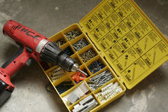 Power Drill and Hardware. A box of hardware used with power drill Stock Image