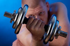 Power of dumbbells Royalty Free Stock Image