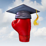 Power Of Education. Concept as a red boxing glove in the air wearing a graduation cap or mortar board as a powerful learning and training success symbol Royalty Free Stock Image