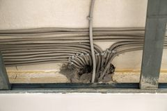 Power electric cables on the ceiling during renovation works Royalty Free Stock Image