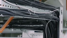 Power electrical cables, electricity and communication on enterprise. Installation of flexible power electrical cables lie in the channels and wrapped with stock video