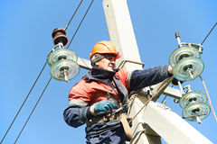 Power Electrician Lineman At Work On Pole Royalty Free Stock Image