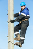 Power electrician lineman at work on pole Stock Photography