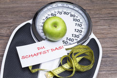 Power of endurance. Concept photography for healthy life with apple, bathroom scales and tape measure stock photography