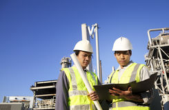 Power and energy engineering. Two engineer power and energy discussion on location site Stock Images